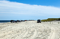 Permitted vehicles allowed to drive on the Nauset Beach, Orleans, Cape Cod, Massachusetts, USA.