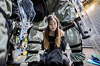 HONG KONG.<br /> INSIDE POLICE FORCE FEATURE:<br /> A young female demonstrator is arrested by police during clashes in the Causeway Bay area of Hong Kong.<br /> Support for the police force used to be strong in Hong Kong, but since the pro-democracy movement began in June this year, support has dramatically dropped due to their violent tactics and heavy handedness.