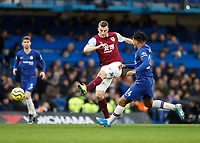 11th January 2020; Stamford Bridge, London, England; English Premier League Football, Chelsea versus Burnley; Chris Wood of Burnley with a volley shot past Reece James of Chelsea - Strictly Editorial Use Only. No use with unauthorized audio, video, data, fixture lists, club/league logos or 'live' services. Online in-match use limited to 120 images, no video emulation. No use in betting, games or single club/league/player publications