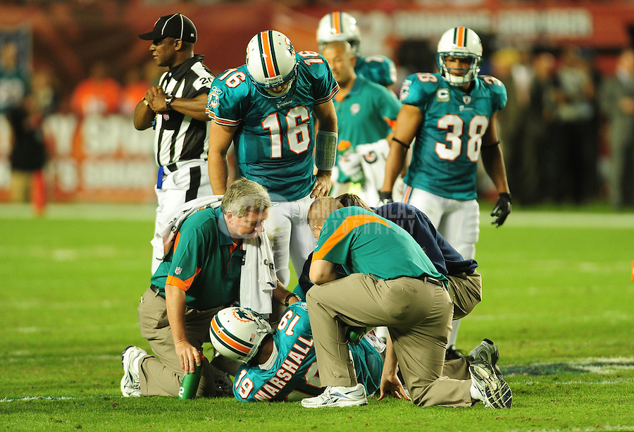 Nov. 18, 2010;  Miami, FL, USA; Miami Dolphins quarterback (16) Tyler Thigpen looks on as trainers tend to injured wide receiver (19) Brandon Marshall in the second quarter against the Chicago Bears at Sun Life Stadium. Mandatory Credit: Mark J. Rebilas-