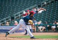 NWA Democrat-Gazette/CHARLIE KAIJO Northwest Arkansas Naturals pitcher Emilio Ogando (23) throws a pitch during a baseball game, Sunday, May 13, 2018 at Arvest Ballpark in Springdale.