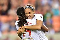 Houston, TX - Sunday Oct. 09, 2016: Jaelene Hinkle, Jessica McDonald, celebrate during the National Women's Soccer League (NWSL) Championship match between the Washington Spirit and the Western New York Flash at BBVA Compass Stadium.