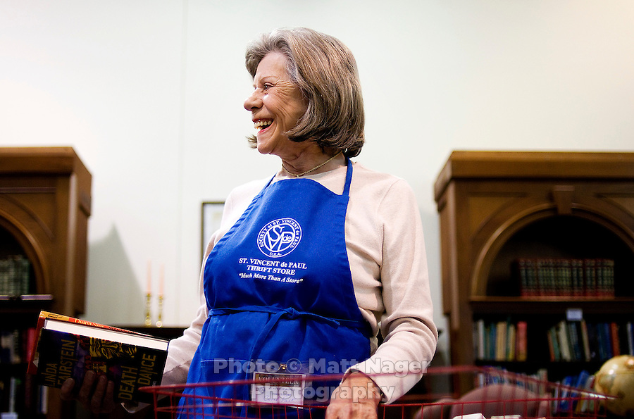 Volunteer Carol Pask (cq, 214.691.7585), laughs while working in the library at St. Vincent de Paul Thrift Store in Dallas, Texas, Tuesday, March 25, 2008. The thrift store opened about four years ago and all proceeds go to the needy. They hope to earn a profit by next year...PHOTO/ MATT NAGER