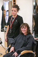 Student with her very happy client in the Arena Salon, Hair & Beauty Dept., Kingston College.