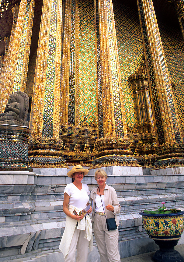 Grand Palace tourists looking at Emerald Palace in Bangkok Thailand