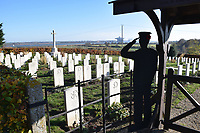 WW2 graves in Shotley church graveyard.  The graveyard also contains WW1graves both from the UK & Commonwealth. Felixstowe docks in the background. Suffolk Nov 2018 UK