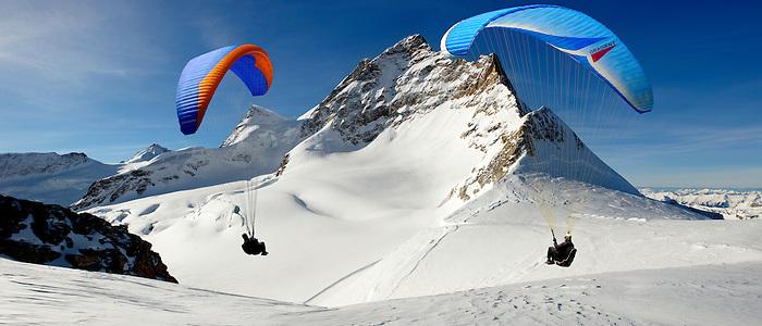 Paragliders in the Swiss Alps near the Jungfrau peak - Swiss Alps - Switzerland