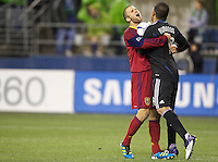 Real Salt Lake defender Chris Wingert, left, hugs goalkeeper Nick Rimando after playoff match against the Seattle Sounders FC at CenturyLink Field in Seattle Wednesday November 2, 2011. The Sounders won the match 2-0, but lost the series.