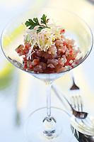 A fresh salad of tuna fish served in a cocktail glass