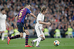 Real Madrid CF's Luka Modric and FC Barcelona's Sergio Busquets during the King's Cup semifinals match. February 27,2019. (ALTERPHOTOS/Alconada)