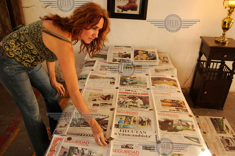 Rosa Maria Robles is a Culiacan based artist who uses items related to drug violence in her work. She covers a bed with sheets of front page newspapers about murders, kidnappings, disapearances,  executions and other acts of violence in Culiacan. Culiacan is the state capital of Sinaloa, home base of the feared Sinaloa drugs cartel that is involved in a bloody power struggle with the Juarez cartel about lucrative smuggling routes..
