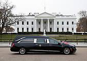 The hearse carrying the flag-draped casket of former President George H.W. Bush passes by the White House from the Capitol, heading to a State Funeral at the National Cathedral, Wednesday, Dec. 5, 2018, in Washington. <br /> Credit: Jacquelyn Martin / Pool via CNP
