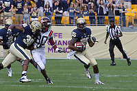 Jason Hendricks (25) returns an interception as Manny Williams (36) puts a block on the receiver Demitri Knowles (80). The Pitt Panthers defeated the Virginia Tech Hokies 35-17 at Heinz field in Pittsburgh, PA on September 15, 2012.