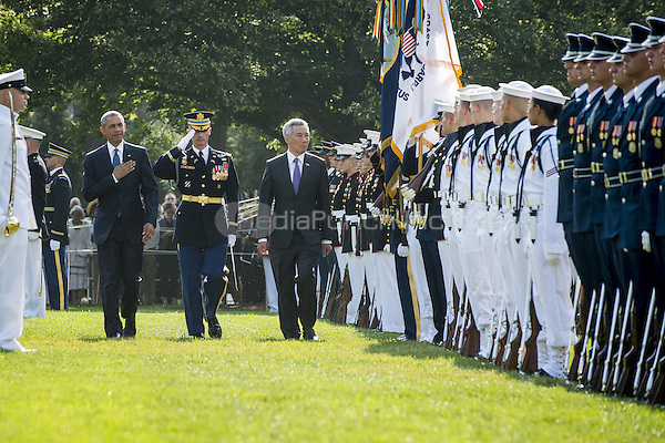 United States President Barack Obama and Prime Minister Lee Hsien Loong of Singapore review the troops during official welcoming ceremonies on the South Lawn of the White House in Washington, DC on August 2, 2016. Lee is on a State Visit to the United States.  <br /> Credit: Pete Marovich / Pool via CNP/MediaPunch