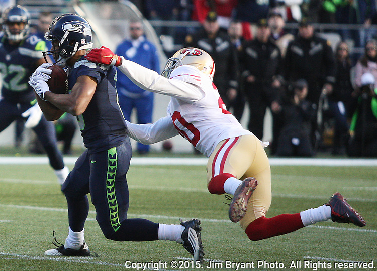 Seattle Seahawks wide receiver Tyler Lockett  (16) breaks the tackle of San Francisco 49ers defensive back Kenneth Ackers (20) as he heads towards the end zone at CenturyLink Field in Seattle, Washington on November 22, 2015.  The Seahawks beat the 49ers 29-13.   ©2015. Jim Bryant Photo. All RIghts Reserved.