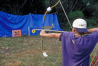 13 year-old Onondaga Iroquois boy doing archery, Nedrow, New York