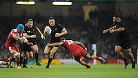 Sonny Bill Williams of New Zealand is tackled by Tamaz Mchedlidze of Georgia during Match 23 of the Rugby World Cup 2015 between New Zealand and Georgia - 02/10/2015 - Millennium Stadium, Cardiff<br /> Mandatory Credit: Rob Munro/Stewart Communications