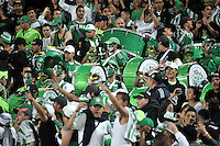BOGOTA - COLOMBIA -07 -05-2014: Hinchas de Atletico Nacional animan a su equipo partido de ida entre Independiente Santa Fe y Atletico Nacional, por las semifinales de la Liga Postobon I-2014, jugado en el estadio Nemesio Camacho El Campin de la ciudad de Bogota. / Fans of Atletico Nacional cheer for their team during a match for the first leg between Independiente Santa Fe and Atletico Nacional, for the semifinals of the Liga Postobon I -2014 at the Nemesio Camacho El Campin Stadium in Bogota city, Photos: VizzorImage / Luis Ramirez / Staff.