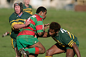 P. Tavia is tackled by B. Feeney & S. Lutumailagi. Counties Manukau Premier Club Rugby, Pukekohe v Waiuku  played at the Colin Lawrie field, on the 3rd of 2006.Pukekohe won 36 - 14