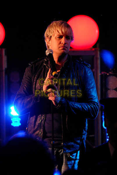 """WESTLIFE - KIAN EGAN.At Harrods to promote their 9th album """"Back Home"""" with signing and performance, London, England..November 5th, 2007.half length black leather jacket stage concert live gig performance music.CAP/FIN.©Steve Finn/Capital Pictures."""