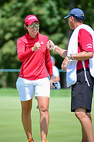 Carlota Ciganda (ESP) fist bumps with her caddie after sinking a long birdie putt on 1 during Sunday's final round of the 72nd U.S. Women's Open Championship, at Trump National Golf Club, Bedminster, New Jersey. 7/16/2017.<br /> Picture: Golffile | Ken Murray<br /> <br /> <br /> All photo usage must carry mandatory copyright credit (&copy; Golffile | Ken Murray)