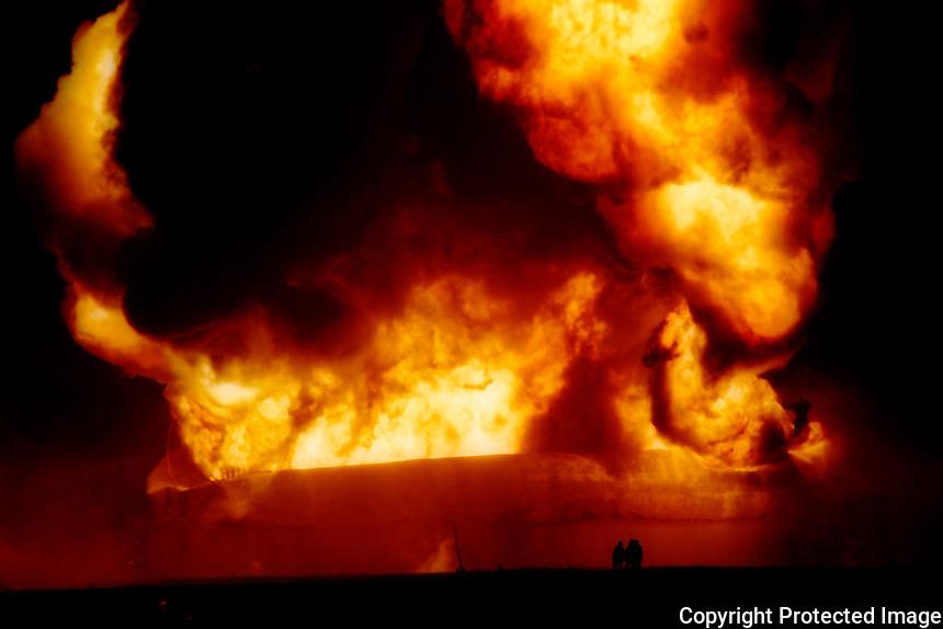Winner 1997 Western Ontario Newspaper Awards, Ford Spot News photography award. Sarnia's Suncor Refinery tank hit by lightning.