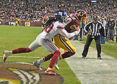 Washington Redskins wide receiver Josh Doctson (18) is forces out of bounds by New York Giants cornerback Janoris Jenkins (20) after scoring what would prove to be the game-winning touchdown at FedEx Field in Landover, Maryland on Thursday, November 23, 2017.  The Redskins won the game 20 - 10.<br /> Credit: Ron Sachs / CNP<br /> (RESTRICTION: NO New York or New Jersey Newspapers or newspapers within a 75 mile radius of New York City)