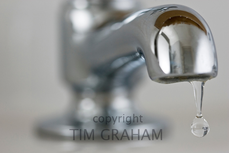 Water drips from a domestic tap, United Kingdom RESERVED USE - NOT FOR DOWNLOAD -  FOR USE CONTACT TIM GRAHAM