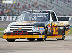 NASCAR trucks and drivers in action during the IZOD Indycar Firestone 550 race at Texas Motor Speedway in Fort Worth,Texas.