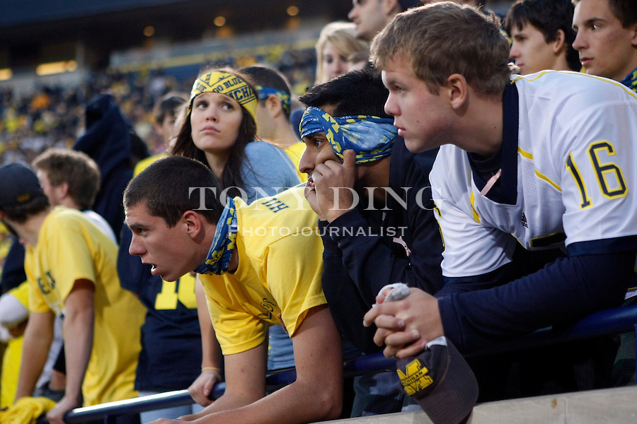 Michigan student fans react to game action in the fourth quarter of an NCAA college football game with Iowa, Saturday, Oct. 16, 2010, in Ann Arbor, Mich. Iowa won 38-28. (AP Photo/Tony Ding)