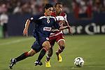24 July 2007:  Francisco Javier Rodriguez (l) of CD Guadalajara moves the ball past Ricardinho (34) of FC Dallas.  FC Dallas tied Chivas de Guadalajara 1-1 at Pizza Hut Park in Frisco, Texas, in the opening match of SuperLiga 2007.