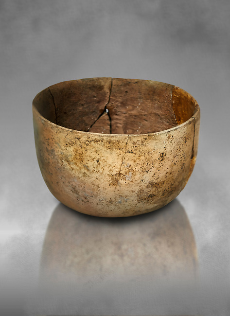 Neolithic terracotta bowl. Catalhoyuk collection, Konya Archaeological Museum, Turkey. Against a grey background