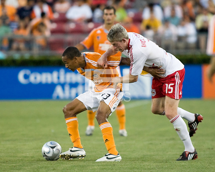 Houston Dynamo midfielder Ricardo Clark (13) holds of New York Red Bulls forward John Wolyniec (15).  Houston Dynamo defeated  New York Red Bulls 1-0 at Robertson Stadium in Houston, TX on May 31, 2008.
