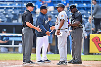 Umpire Colin Baron, Asheville Tourists manager Robinson Cancel, Charleston RiverDogs manager Julio Mosquera (29) and home plate umpire James Jean before game one of a double header at McCormick Field on April 9, 2019 in Asheville, North Carolina. The Tourists defeated the RiverDogs 17-3. (Tony Farlow/Four Seam Images)