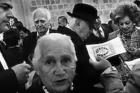 Greek Cypriots lining up to receive the traditional koliva after Sunday mass