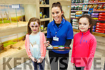 Ruby and Ella Farrell from Moyvane with the Petstop Assistant manager Tracey Ahern at the opening of the Pet Stop in Manor on Saturday.