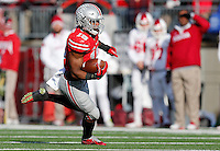 Ohio State Buckeyes running back Ezekiel Elliott (15) runs the ball in the fourth quarter of the college football game between the Ohio State Buckeyes and the Indiana Hoosiers at Ohio Stadium in Columbus, Saturday afternoon, November 22, 2014. The Ohio State Buckeyes defeated the Indiana Hoosiers 42 - 27. (The Columbus Dispatch / Eamon Queeney)