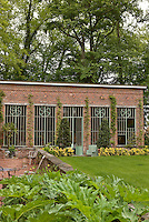 The elegant facade of the orangery viewed from the garden
