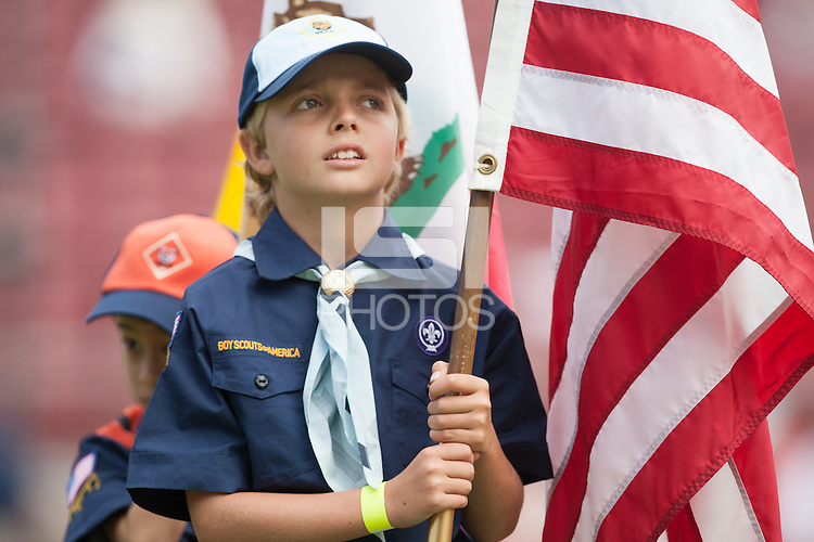 STANFORD, CA -- October 06, 2012: A cub scout holds the American flag before the Stanford vs Arizona football game Saturday afternoon at Stanford Stadium.<br /> <br /> Stanford won 54-48.