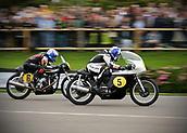 10th September 2017, Goodwood Estate, Chichester, England; Goodwood Revival Race Meeting; A pair of Norton Manx vintage bikes race through the Goodwood straight