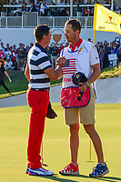 Rickie Fowler (USA) shakes hands with his caddie Joe Skovron after winning his match over Emiliano Grillo (ARG) during round 4 Singles of the 2017 President's Cup, Liberty National Golf Club, Jersey City, New Jersey, USA. 10/1/2017. <br /> Picture: Golffile | Ken Murray<br /> <br /> All photo usage must carry mandatory copyright credit (&copy; Golffile | Ken Murray)