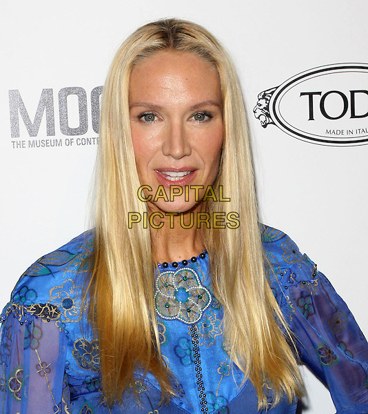 KELLY LYNCH.Tod's Beverly Hills boutique Grand Opening held At Tod's Boutique, Beverly Hills, California, USA. .April 15th, 2010 .headshot portrait blue purple print gold patterned.CAP/ADM/KB.©Kevan Brooks/AdMedia/Capital Pictures.