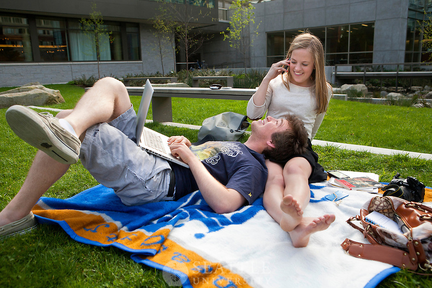 04092012-  A couple relaxes outside the Library on the grass during a warm Spring day on campus.
