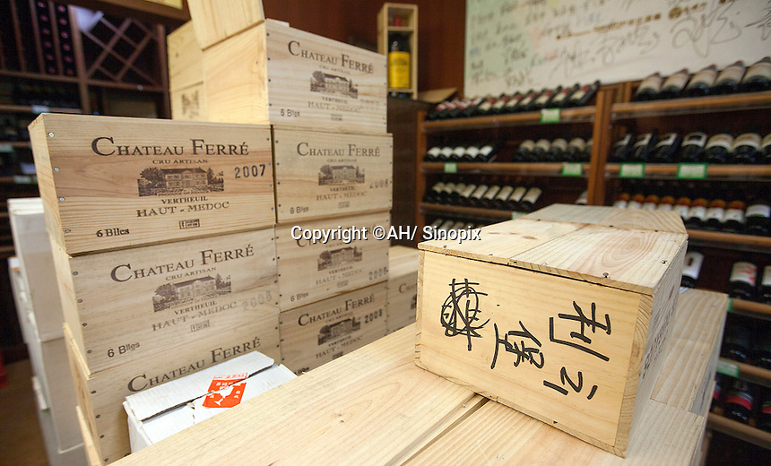 Purportedly French crates of wine with Chinese writing on them are seen in a shop that sells real and fake wine, Guangzhou, Guangdong Province, China, 18 July 2014. <br /> <br /> PHOTO BY SINOPIX