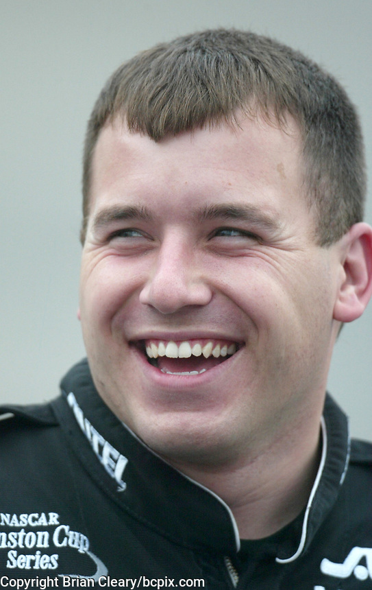 Ryan Newman laughs as he waits to qualify for  the Pop Secret 400 NASCAR Winston Cup race at Rockingham, NC on Friday, November 7, 2003. (Photo by Brian Cleary)