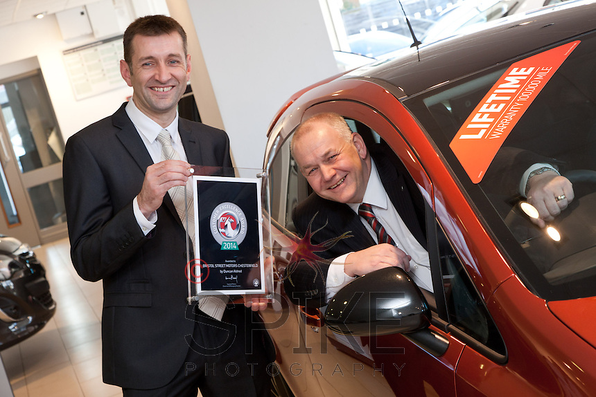 Ian Dodd, Vauxhall Plant Quality Director (left) presents the Customer Excellence Award to Mike Herring, General Manager