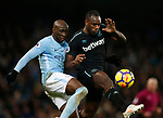 Eliaquim Mangala of Manchester City tackles Michail Antonio of West Ham United  during the premier league match at the Etihad Stadium, Manchester. Picture date 3rd December 2017. Picture credit should read: Andrew Yates/Sportimage
