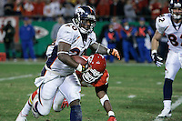 Denver Broncos RB Mike Bell runs for some yardage in the second half as Kansas City linebacker Keyaron Fox attempts the tackle at Arrowhead Stadium in Kansas City, Missouri on November 23, 2006. The Chiefs won 19-10.
