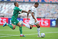 Rhian Brewster of Swansea City under pressure from Liam Palmer of Sheffield Wednesday during the Sky Bet Championship match between Swansea City and Sheffield Wednesday at the Liberty Stadium in Swansea, Wales, UK. Sunday 05 July 2020