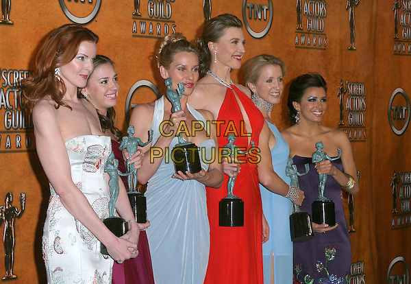 MARCIA CROSS, ANDREA BOWEN, NICOLLETTE SHERIDAN, BRENDA STRONG, FELICITY HUFFMAN & EVA LONGORIA.11th Annual Screen Actors Guild Awards (SAG) held at the Shrine Auditorium. Los Angeles, California.Photo Credit: Jacqui Wong/AdMedia.February 5th, 2005.half length, award, trophy, strapless, halterneck, despertae housewives cat Nicolette.www.capitalpictures.com.sales@capitalpictures.com.© Capital Pictures.